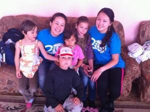 FLEX alumni at the orphanage on June 1_left Tolgonai Turgazieva_right Sanira Begim Mamatova