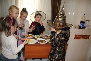 Kids with Halloween snacks